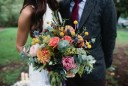 vibrant bouquet with roses and billy buttons